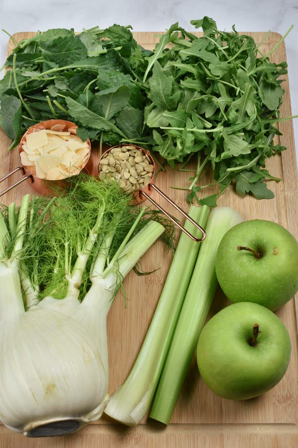 Apple Fennel Salad ingredients on a cutting board.