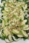 Close-up of apple fennel salad on a platter.