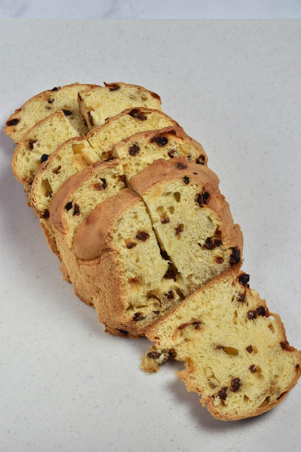 Sliced panettone laid out on a cutting board.